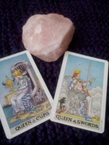 """Are the Queen of Cups and the Queen of Swords really at odds with each other? No, I don't think so. The Queen of Swords will enforce those boundaries that we need. But she wouldn't allow herself to be bullied -- she can tell when words like """"enable"""" are embedded in bullshit. And she would never turn her sword against the Queen of Cups just because the Queen of Cups is so loving. Moreover, if she saw that the Queen of Cups had turned upside down, I think the Queen of Swords would find a way to lend a hand, rather than simply flinging  psychobabble at her."""