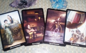 Riding the bus! With the Nine of Pentacles, Four of Cups, Two of Pentacles, and the Six of Swords, from the Steampunk Tarot.