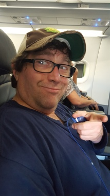 JP smiling on a plane