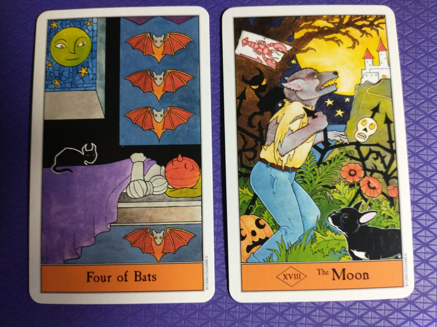 The Four of Bats (Four of Swords) and the Moon from the Halloween Tarot.